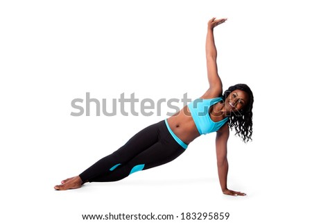 Beautiful woman doing floor pilates yoga workout fitness exercise for health, bodycare concept, t-stand pose. - stock photo