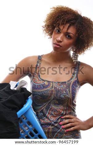 Beautiful woman doing laundry - stock photo