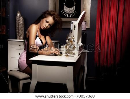 Beautiful woman doing make up - stock photo
