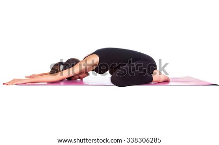 Beautiful woman doing Shashankasana pose on yoga class. Studio shot.