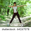 Beautiful Woman Doing Stretching Exercise in the Park - stock photo