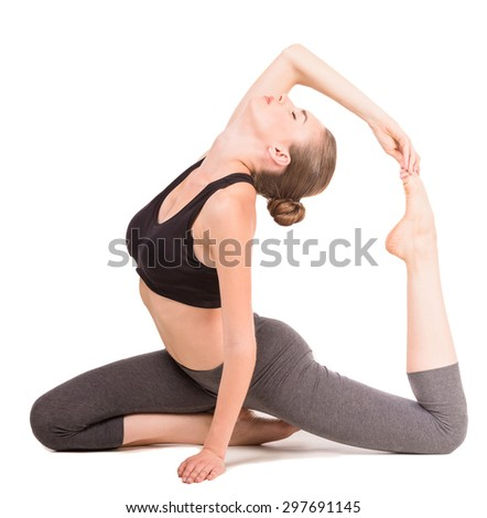 Beautiful woman doing stretching exercises in studio on white background. - stock photo