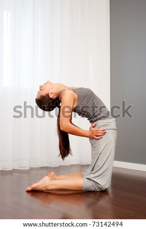 beautiful woman doing yoga exercise - stock photo