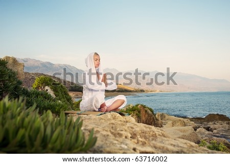 Beautiful woman doing yoga exercise outdoors - stock photo