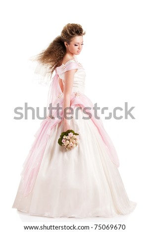 Beautiful woman dressed as a bride over colored background. - stock photo