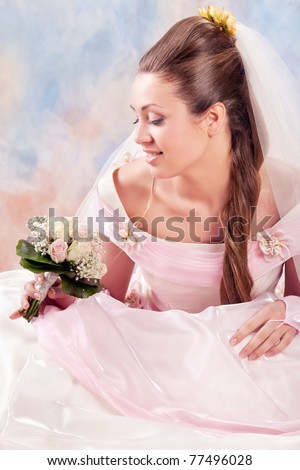 Beautiful woman dressed as a bride over white background