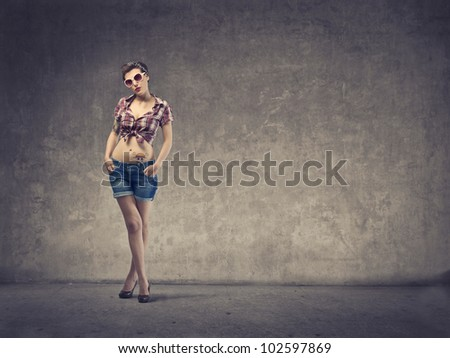 Beautiful woman dressed as a pin up girl - stock photo