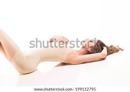beautiful woman dressed in a modeling body - stock photo
