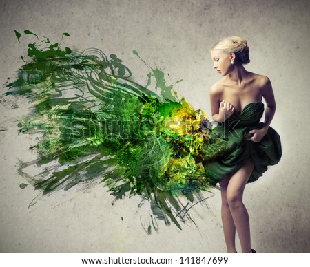 beautiful woman dressed in elegant green dress - stock photo
