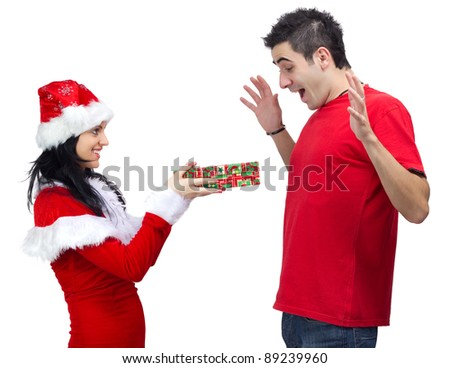 Beautiful woman dressed in Santa Claus offering a gift to young happy man.White background. - stock photo