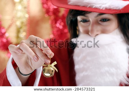 Beautiful woman dressed in santa clause costume. - stock photo