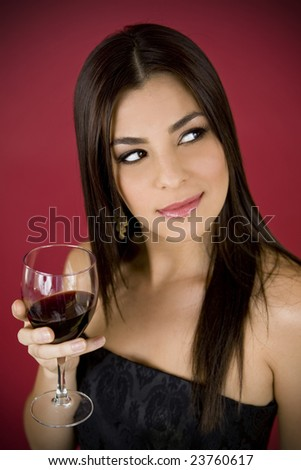 Beautiful woman drinking a glass of red wine - stock photo