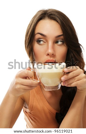 beautiful woman drinking cappuccino coffee looking to side on white background - stock photo