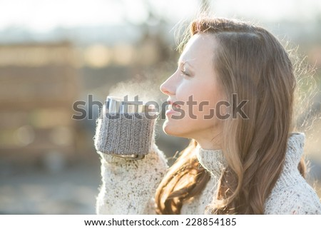 beautiful woman drinking coffee and looking sideways happy smiling  enjoy the life - stock photo