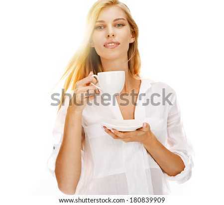 naked woman holding coffee cup
