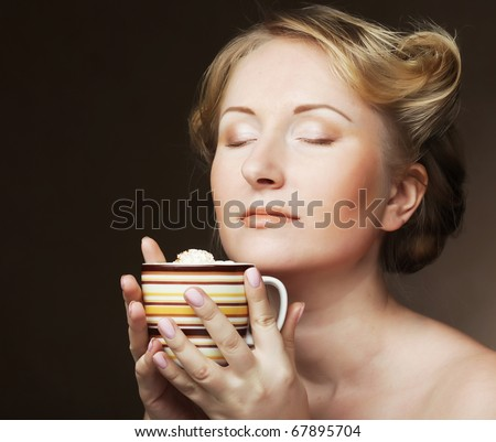 Beautiful woman drinking coffee. studio shot.