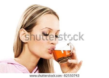 Beautiful woman drinking green tea, white background - stock photo