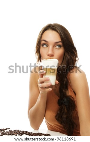 beautiful woman drinking latte macchiato coffee looking to side on white background - stock photo