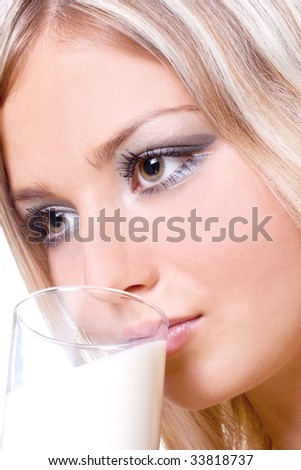 beautiful woman drinking milk on a white background