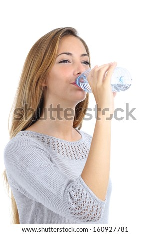 Beautiful woman drinking water from a bottle isolated on a white background             - stock photo