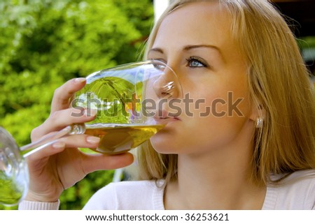 Beautiful woman drinking wine in the restaurant. - stock photo