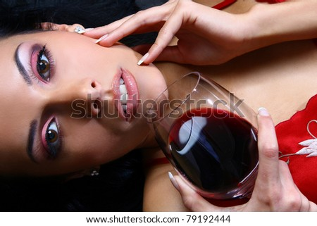 Beautiful woman drinking with glass of red wine - stock photo