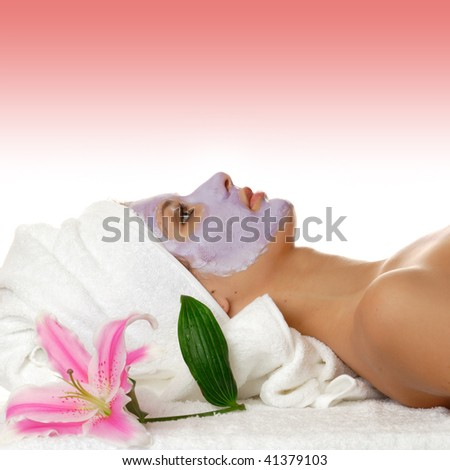 Beautiful woman during the spa treatment isolated on gradient pink background - stock photo