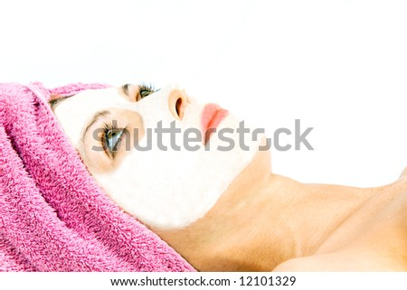 Beautiful woman during the spa treatment isolated on white.