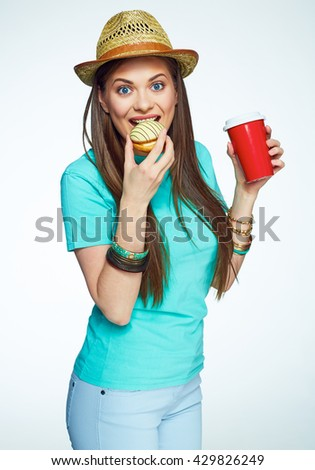 beautiful woman eat cake drink coffee. Isolated. Female model on white. - stock photo