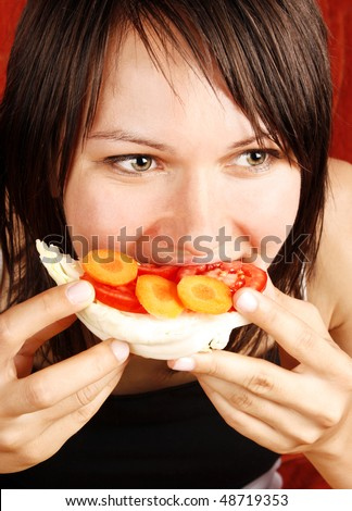 Beautiful woman eating a healthy sandwich - stock photo