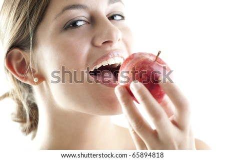 Beautiful woman eating a red apple