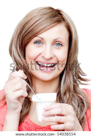 Beautiful woman eating a yogurt against a white background