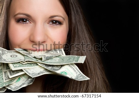 Beautiful woman eating cash money - stock photo