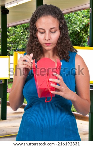 Beautiful woman eating Chinese Japanese or Asian takeout food (photo illustration / image composite)  - stock photo