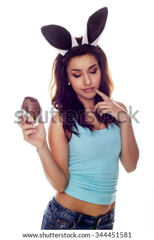 Beautiful woman eating chocolate.  - stock photo