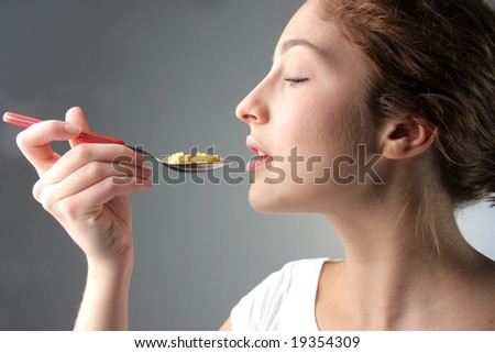 beautiful woman eating cornflakes - stock photo