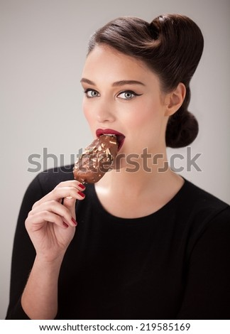 Beautiful woman eating ice cream. Close up. - stock photo