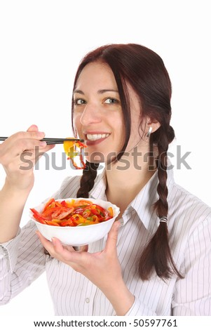 Beautiful woman eating with chopsticks, chinese food - stock photo