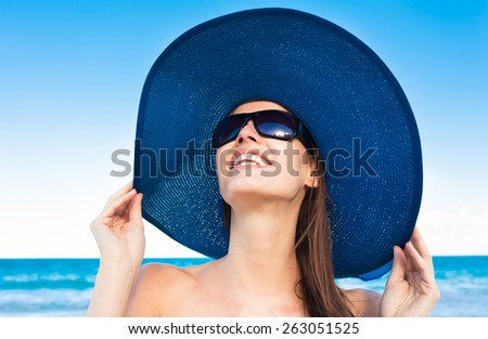 Beautiful woman enjoying a day at the beach - stock photo