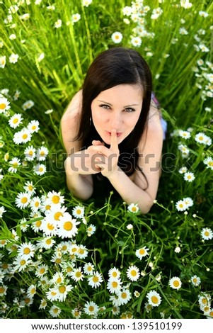 Beautiful woman enjoying daisy field, nice female - stock photo
