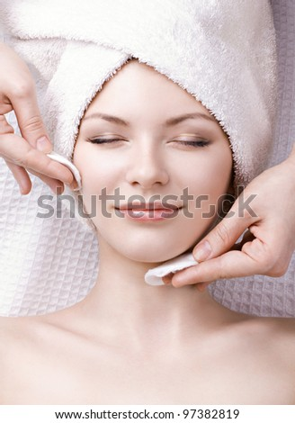 beautiful woman enjoying facial massage - stock photo