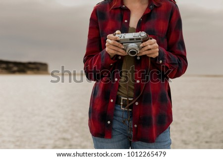 Beautiful woman enjoying her day taking pictures with her camera