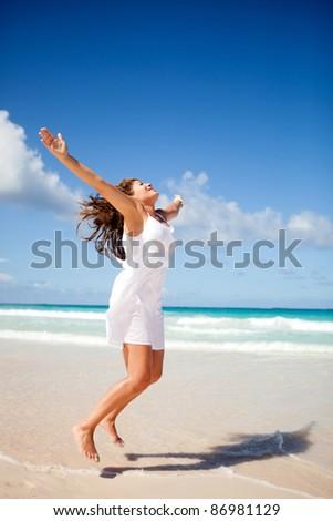 Beautiful woman enjoying her holidays at the beach - stock photo
