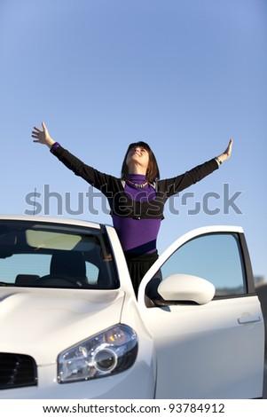 Beautiful woman enjoying her new car - stock photo