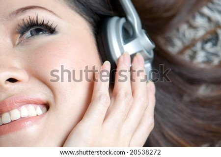 beautiful woman enjoying music close up - stock photo