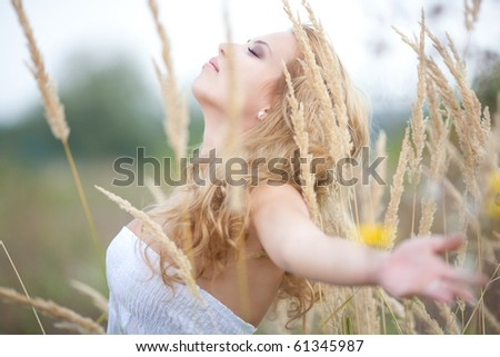Beautiful Woman Enjoying Nature - stock photo
