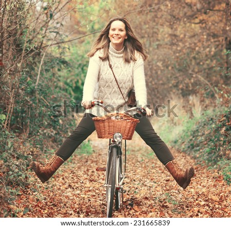 Beautiful woman enjoying nature driving bicycle - stock photo