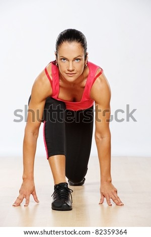 Beautiful woman exercising in fitness club. - stock photo
