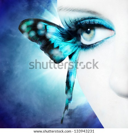 Beautiful woman eye close up with butterfly wings - stock photo
