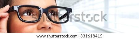 Beautiful woman eyes with eyeglasses. Optician banner background. - stock photo